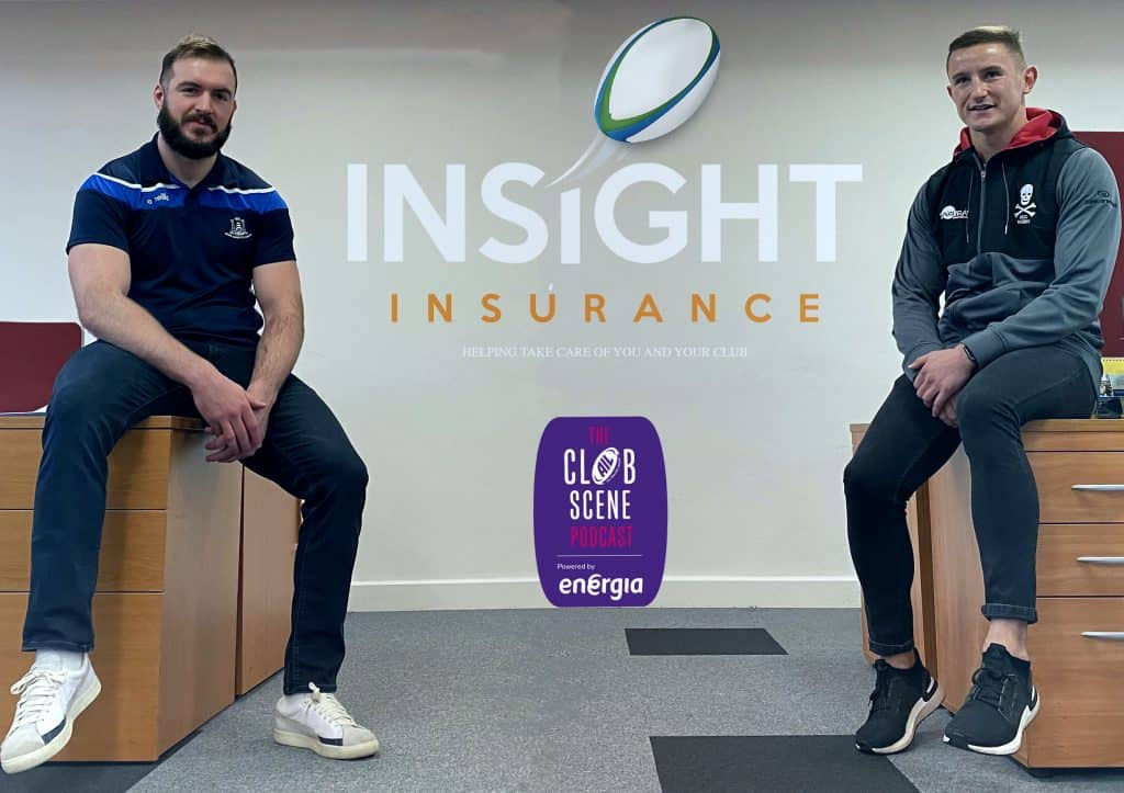 Niall Kenneally and Cian Bohan sitting on office desks with the Insight Insurance and The Clubscence Podcast logos